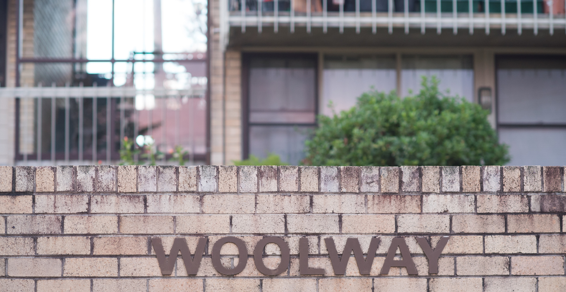 Woolway Sign on Brick Wall